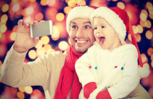 Christmas after divorce, santa hat, happy father & child, divorce, taking a selfie, child custody, child support, holidays