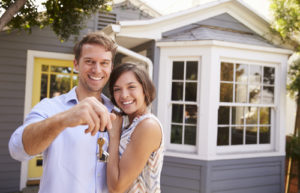 couple buying a house, real estate, handing over key